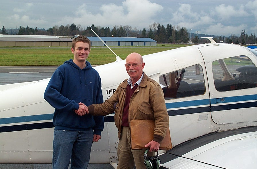 Time Sawatsky receives congratulations from Flight Test Examiner Donn Richardson after the completion of Tim's Commercial Pilot Flight Test.  Langley Flying School.