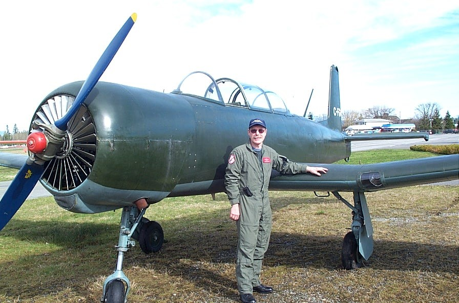 Flight Instructor  Peter Waddington with his Nanchang.  Langley Flying School